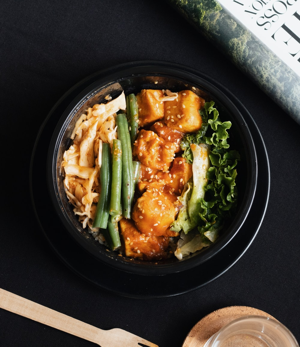 vegetable salad on black ceramic bowl