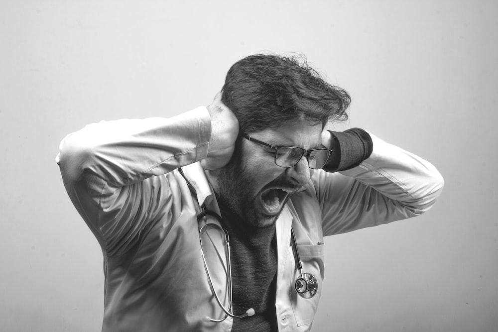 man in gray dress shirt wearing black framed eyeglasses