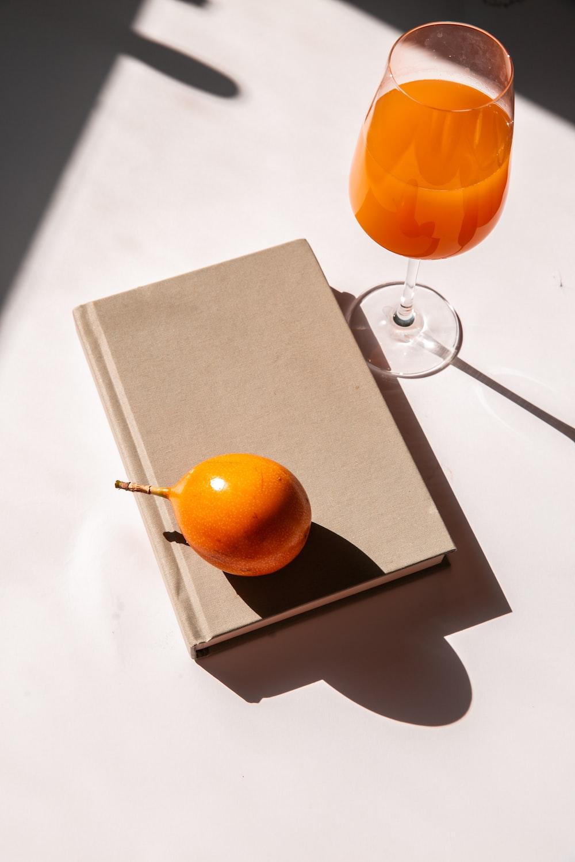 orange fruit on brown box