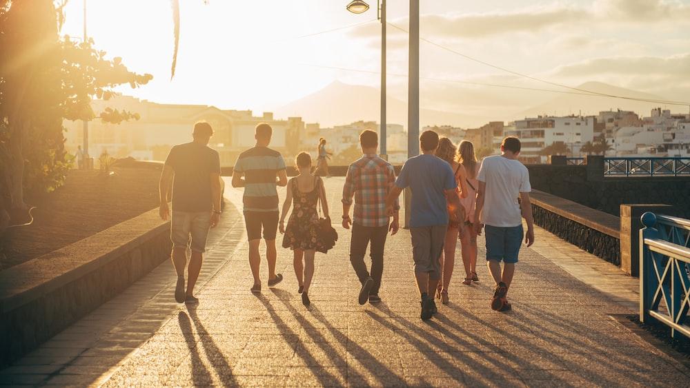 people walking on brown sand during daytime