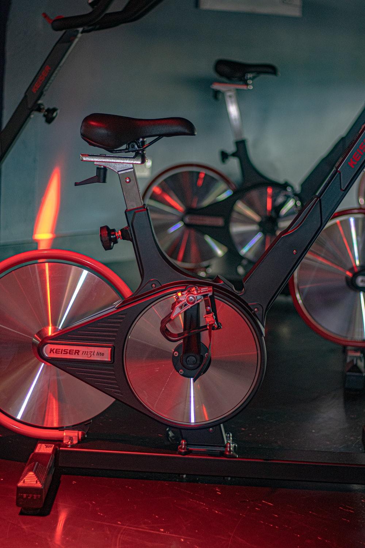 red and black bicycle on black floor