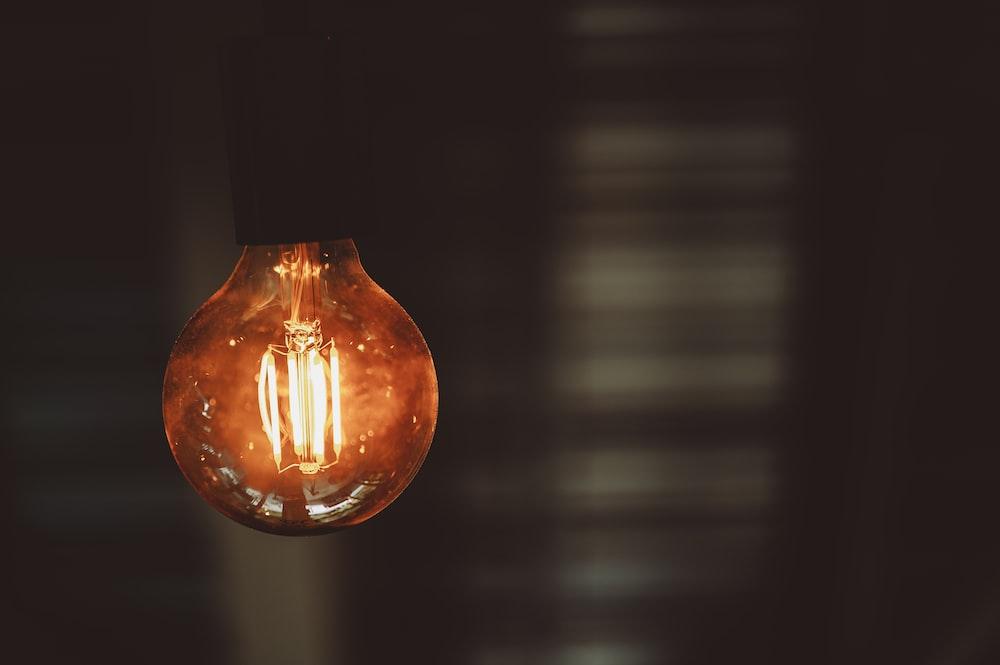 orange light bulb turned on in dim light