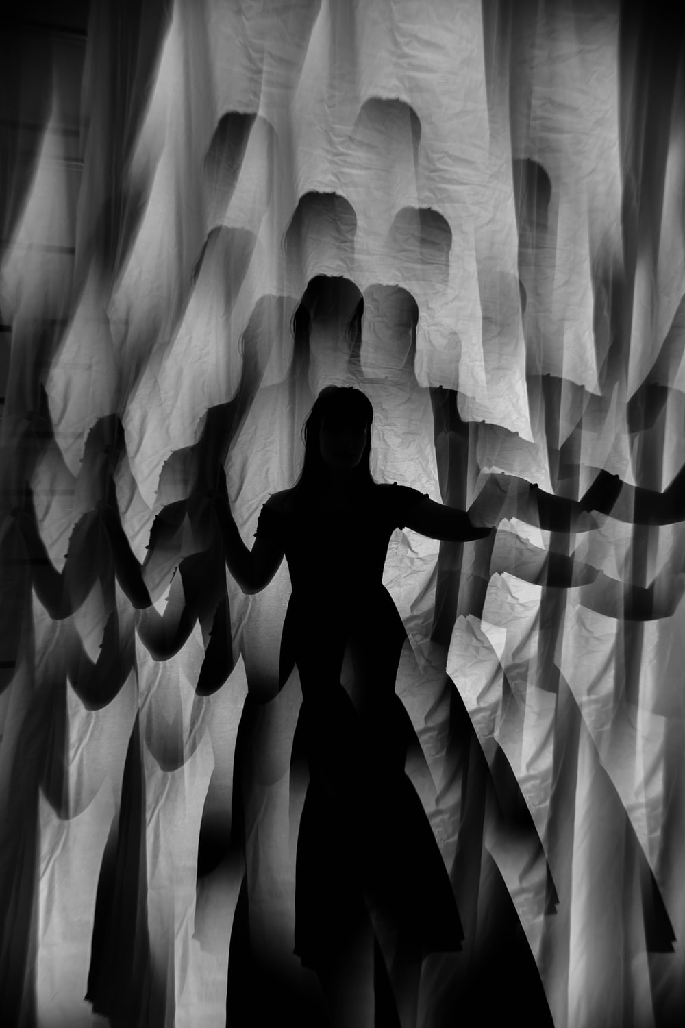 silhouette of man in a white curtain