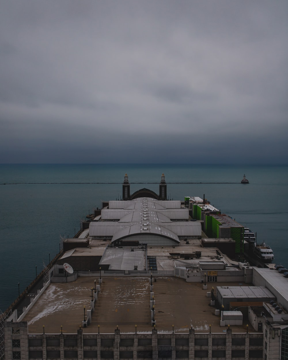gray concrete building near sea under white sky during daytime