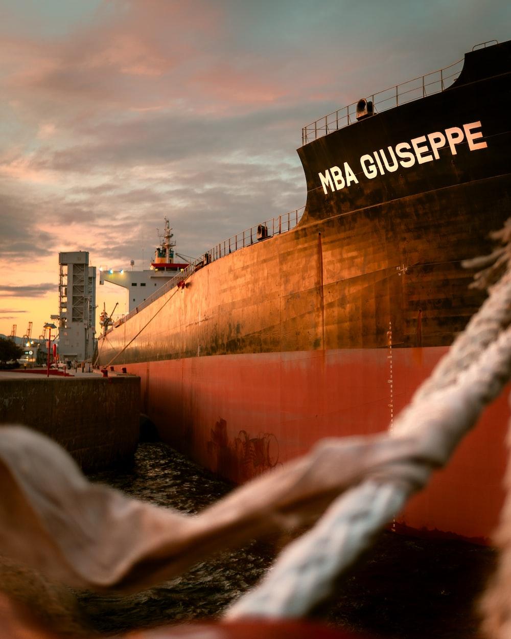 black ship on dock during sunset