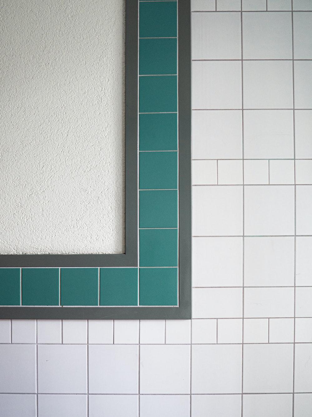 green wooden frame on white ceramic tiles