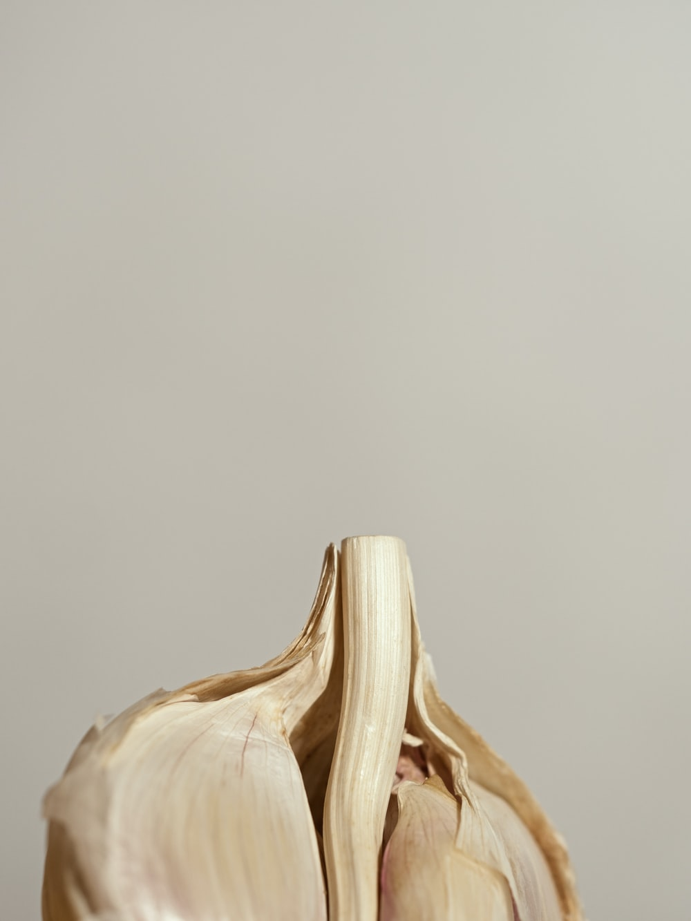 white and brown wooden figurine