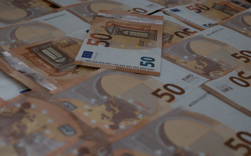 50 euro bill on brown and white table