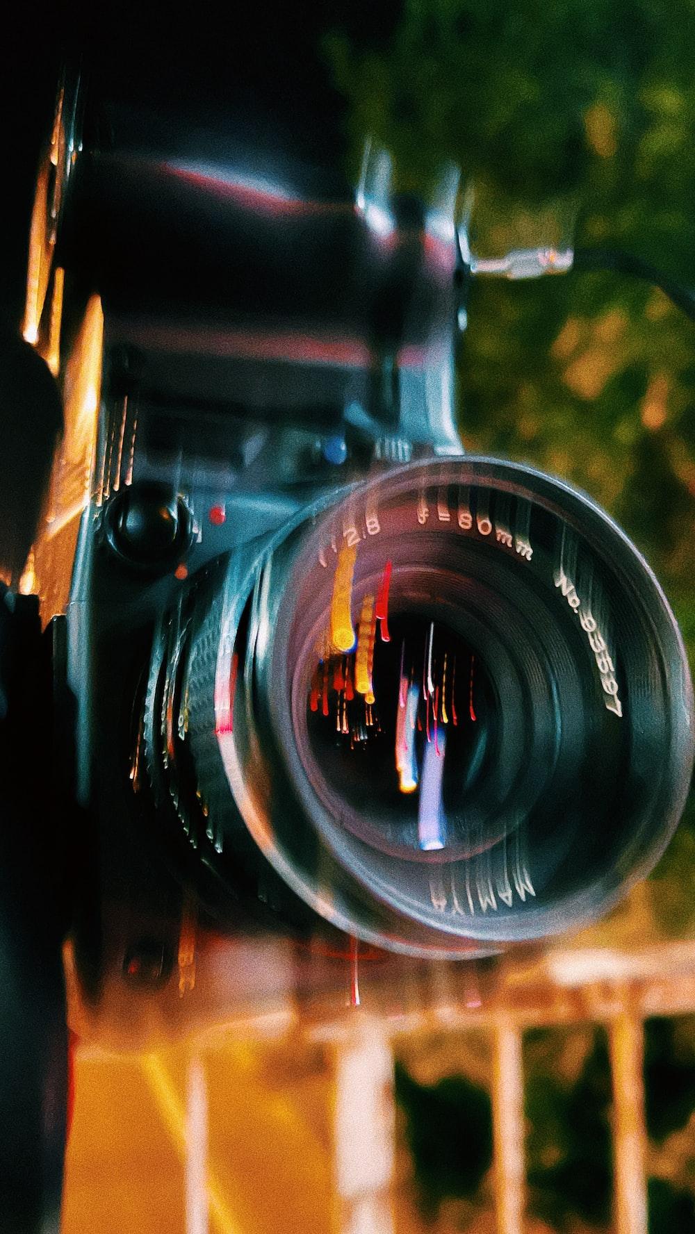 black nikon camera lens in close up photography