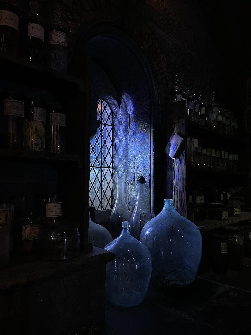 blue glass bottle on brown wooden shelf