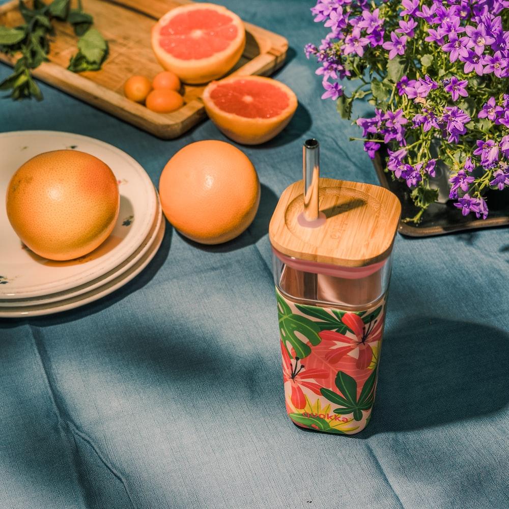 orange fruit on blue and green floral ceramic mug