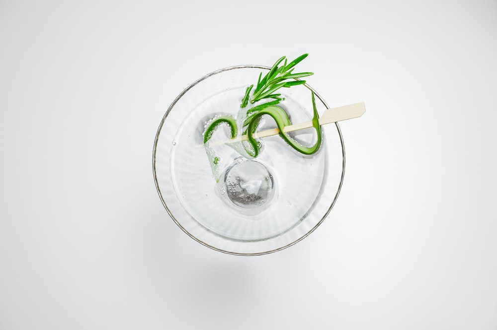 clear glass cup with green plant