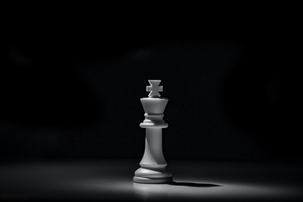 white chess piece on black table