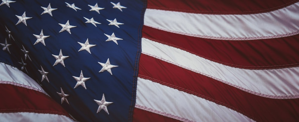 us a flag on white and red striped textile