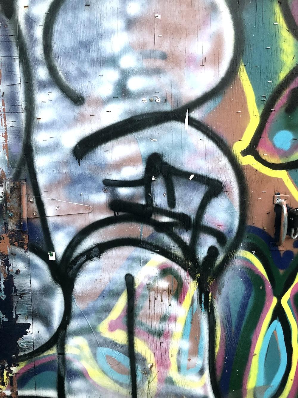 black yellow and blue graffiti