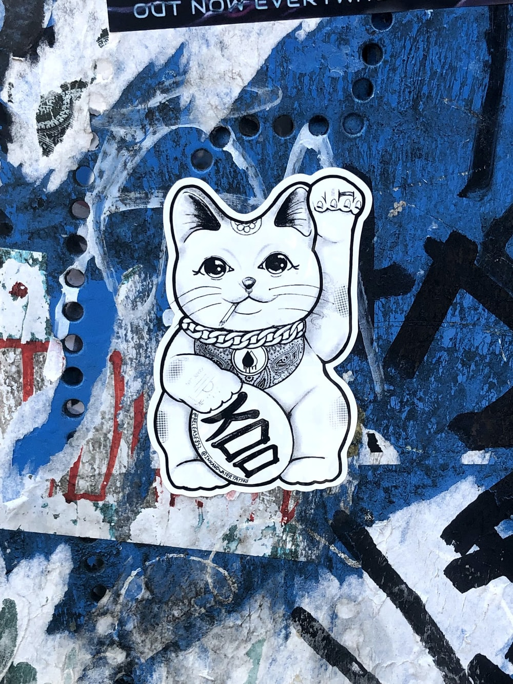 white and blue cat painting
