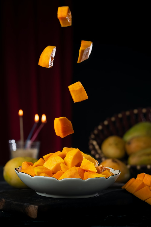yellow candles on white ceramic bowl
