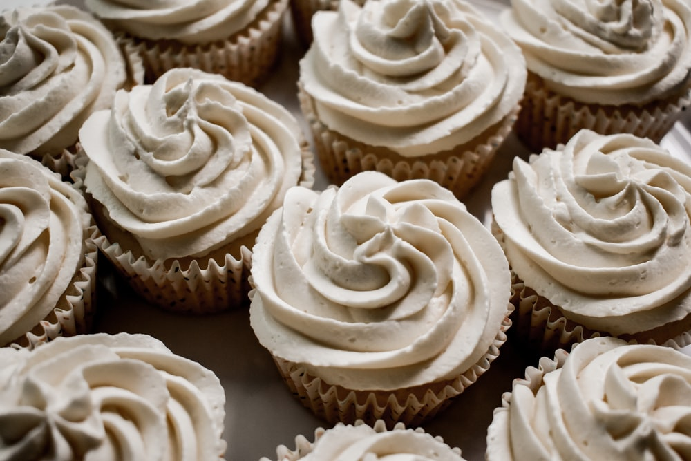 white and brown cupcakes on white paper