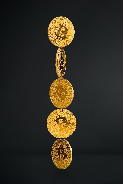 gold round coins on black background