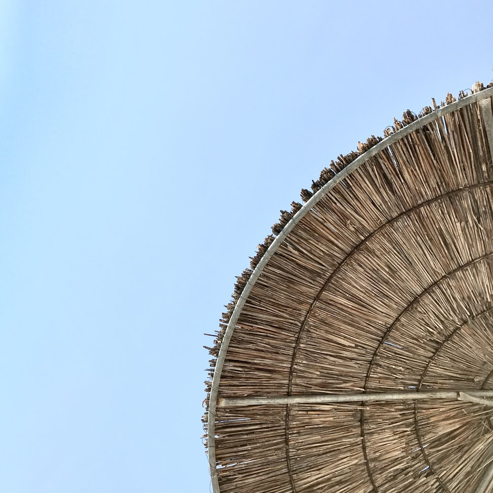 brown and white ferris wheel under blue sky during daytime