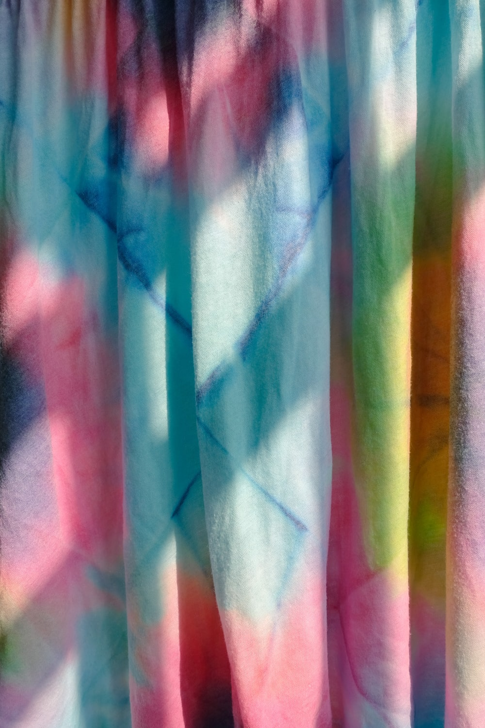 white pink and blue textile