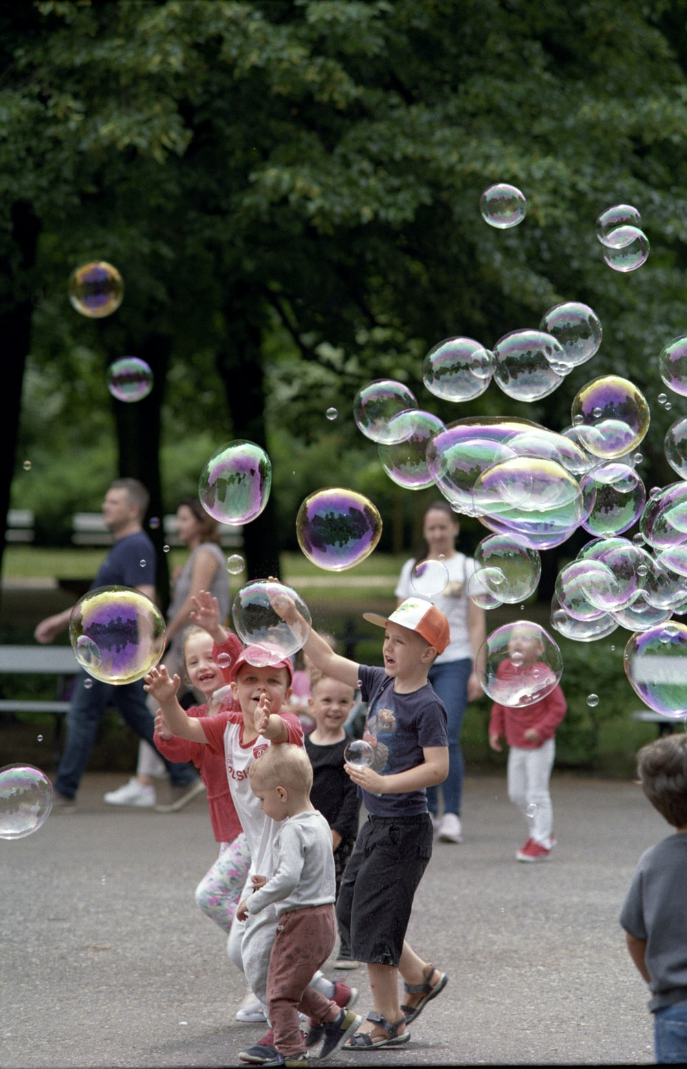 children playing bubbles during daytime