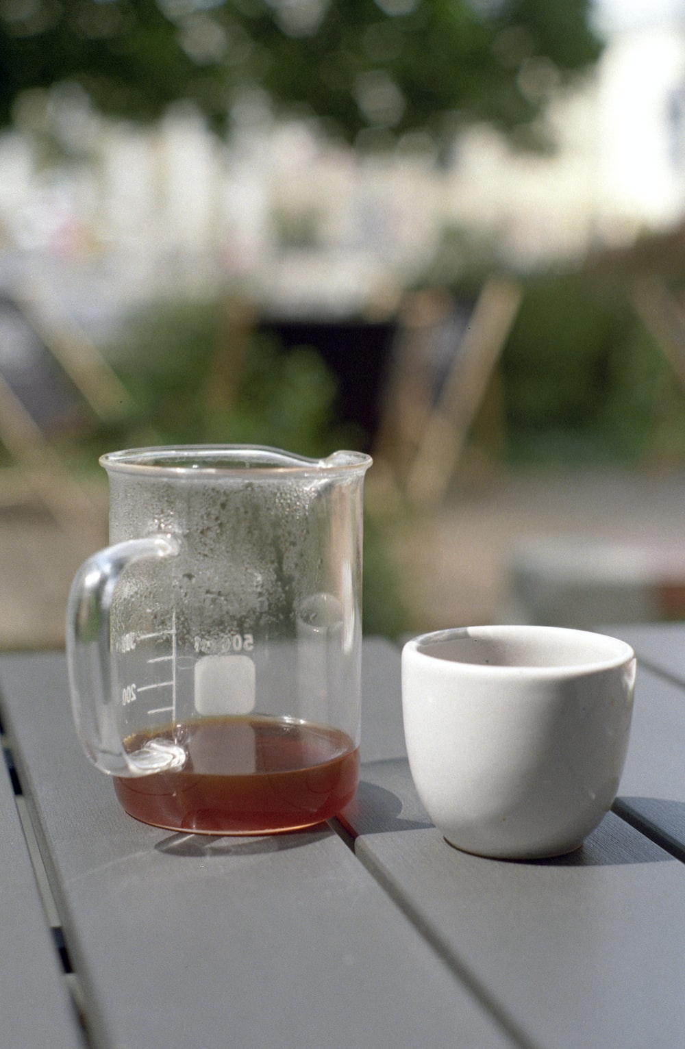 white ceramic pitcher and clear glass pitcher