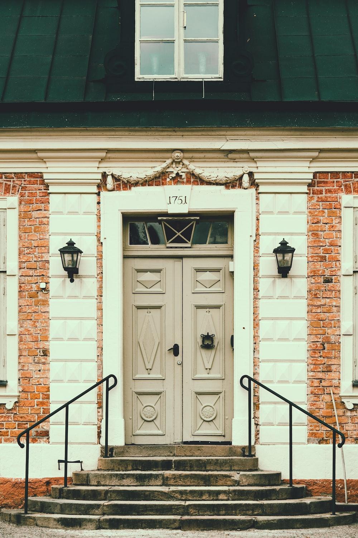 white wooden door on brown brick building