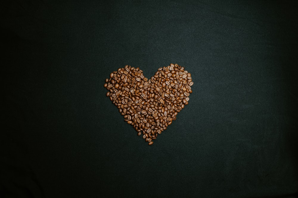 brown and white heart shaped beads on black textile