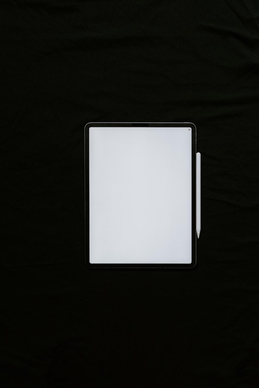 white rectangular device on black textile