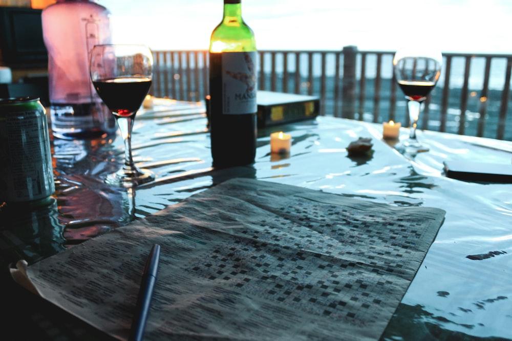 wine bottle beside wine glass on table