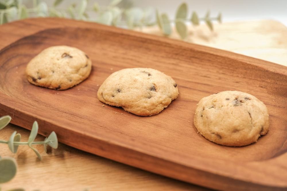 brown cookies on brown wooden chopping board