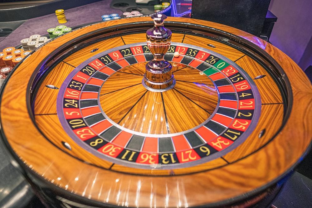 brown and green round analog clock