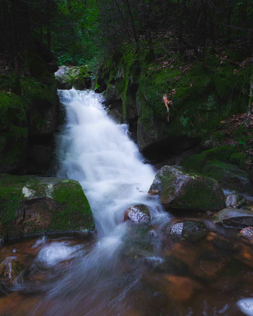 water falls on rocky river