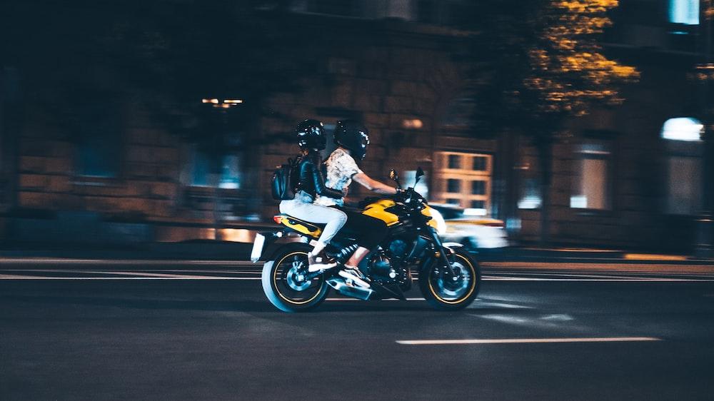 man in black jacket riding motorcycle during night time