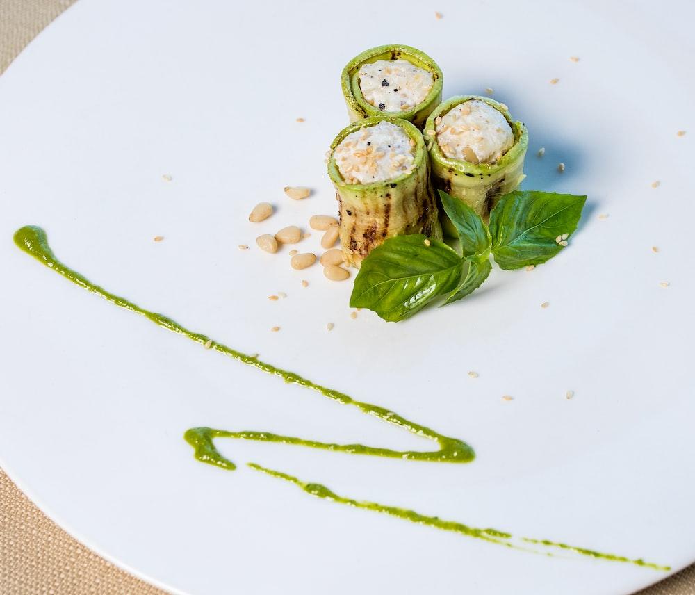 green and white sliced vegetables on white ceramic plate