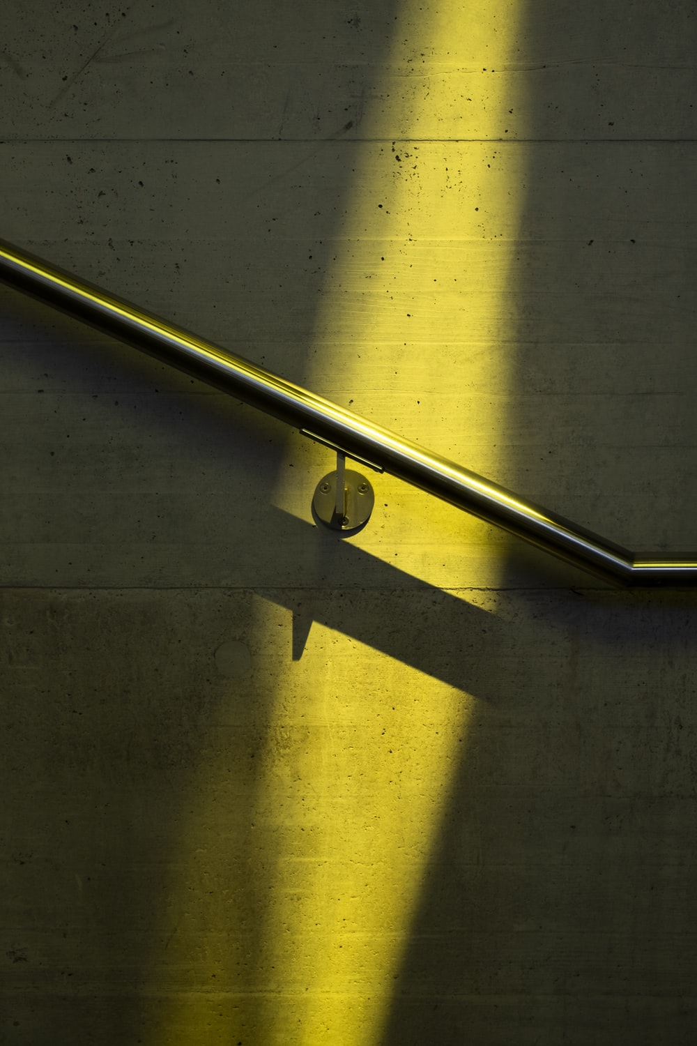 stainless steel railings on yellow and white painted wall