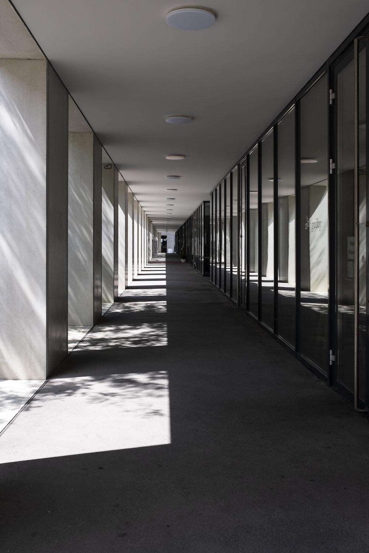 white hallway with black metal railings