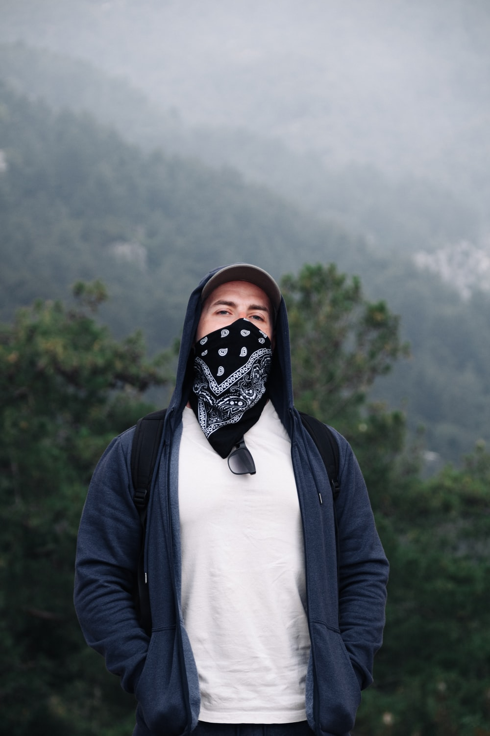 person in black and white mask and black jacket