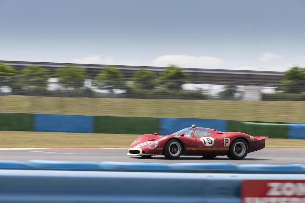 red ferrari 458 italia on road during daytime