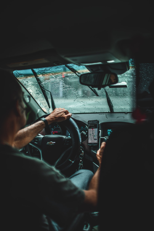man driving car during daytime