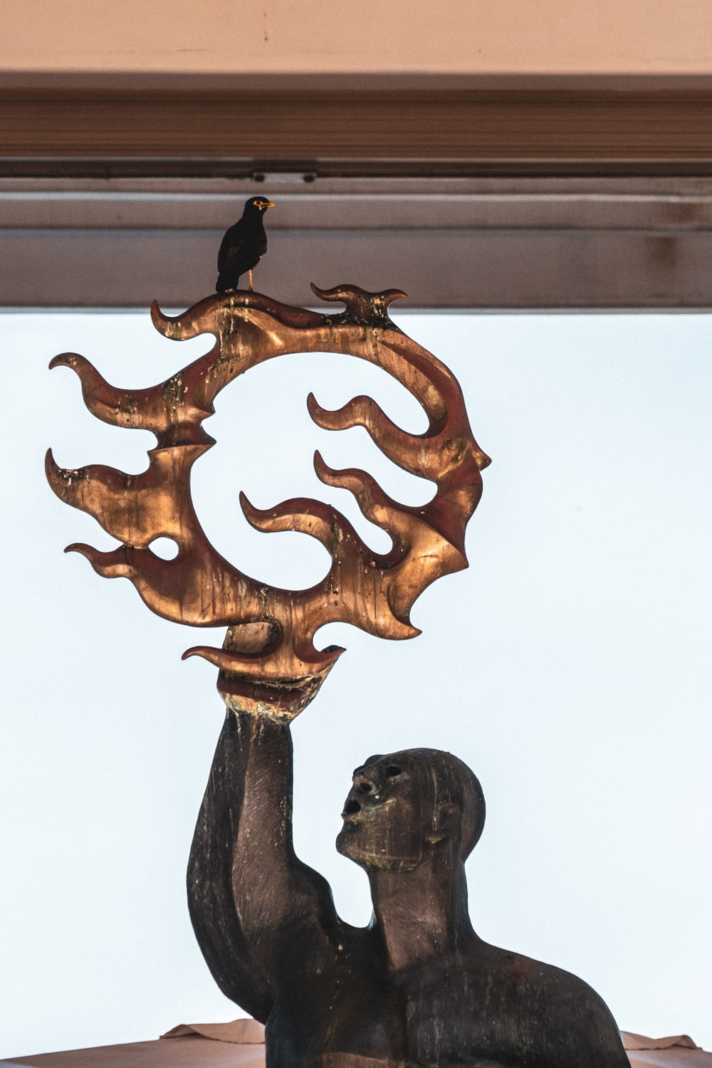 brown wooden bird carved wall decor