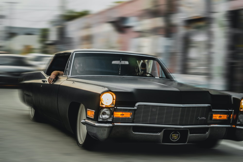 black mercedes benz coupe on road during daytime