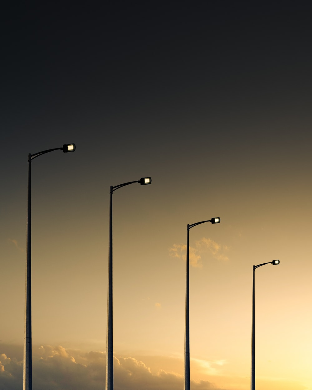 3 light post light turned on during night time