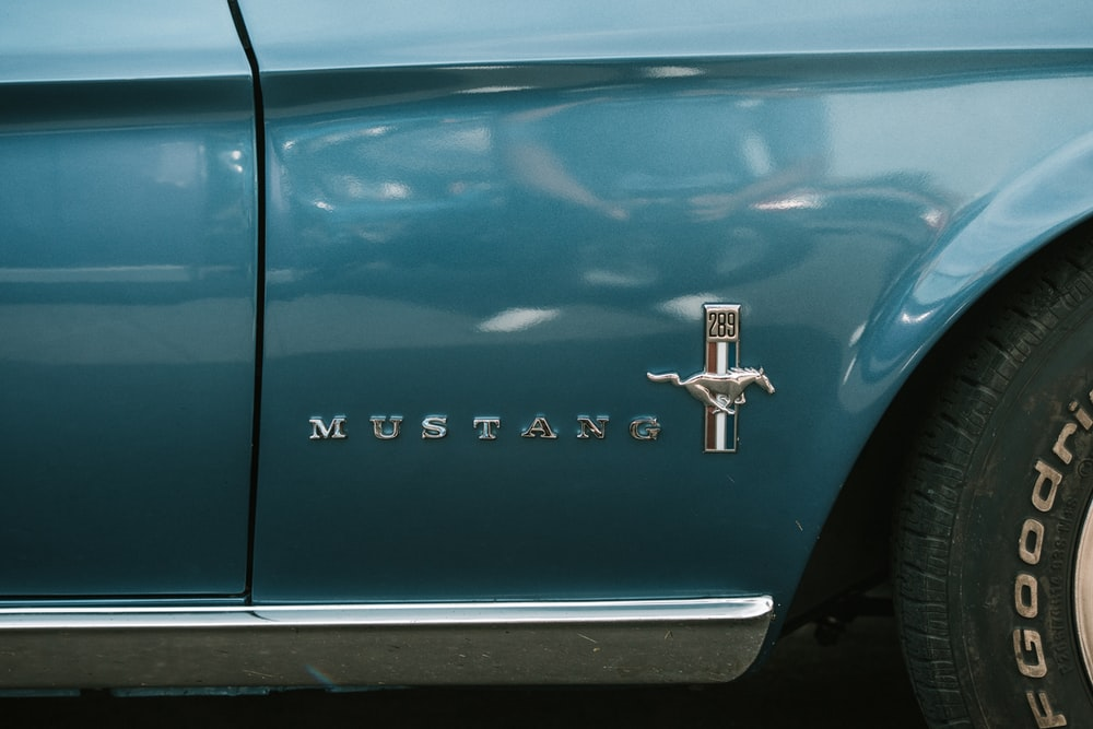 blue chevrolet car with gold cross