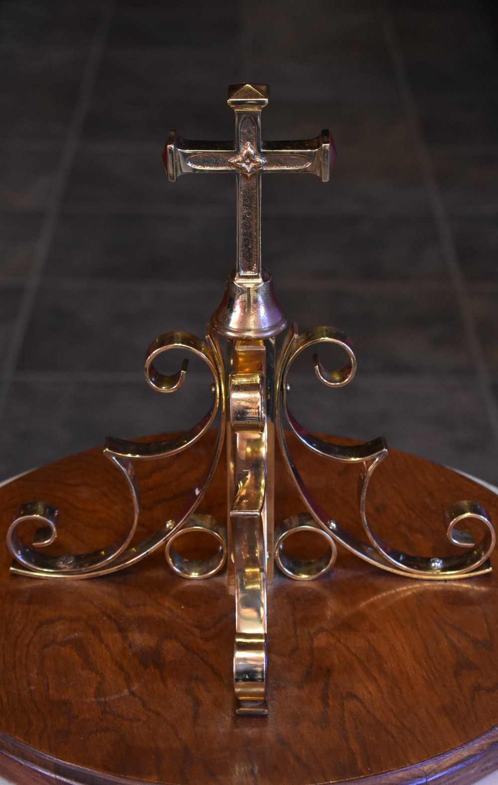 gold cross on brown wooden table