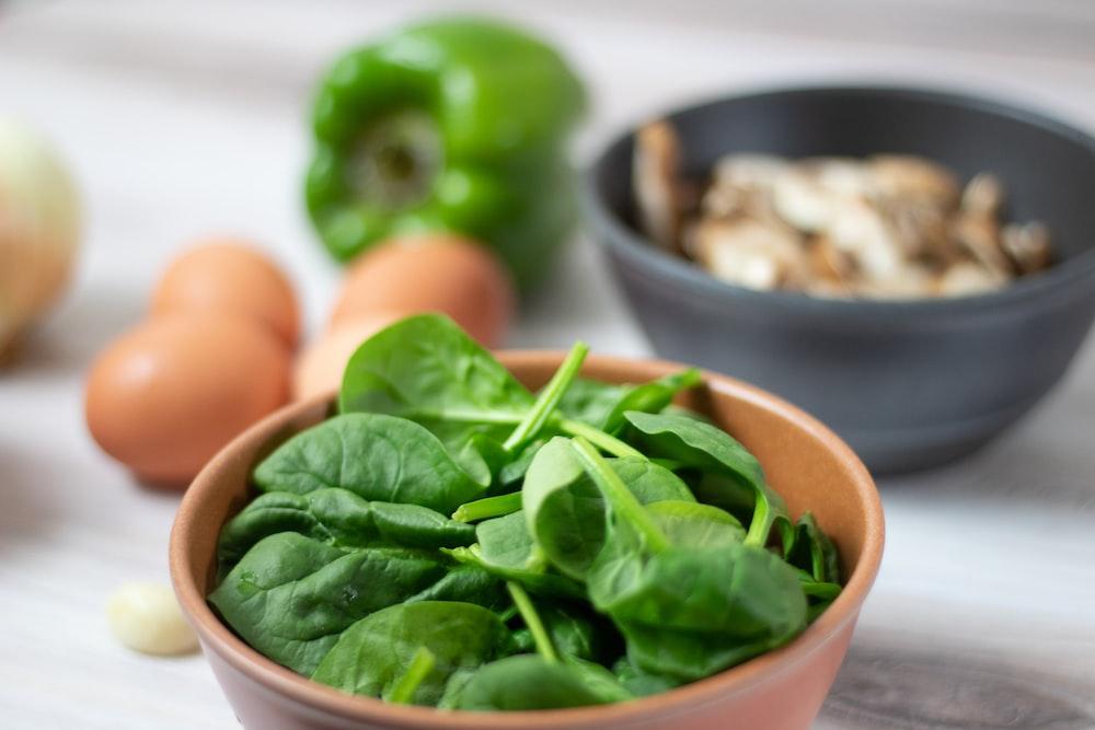 green vegetable on white ceramic bowl