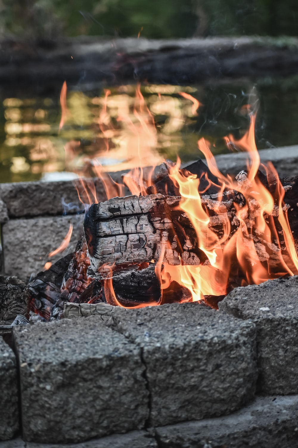 burning firewood on fire pit