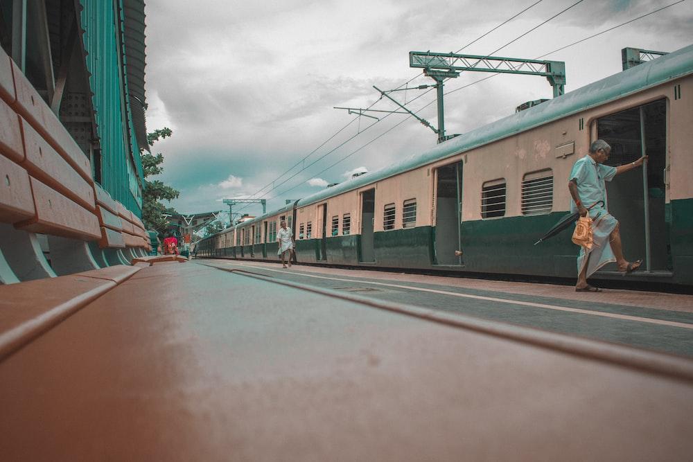 gray and blue train under gray sky