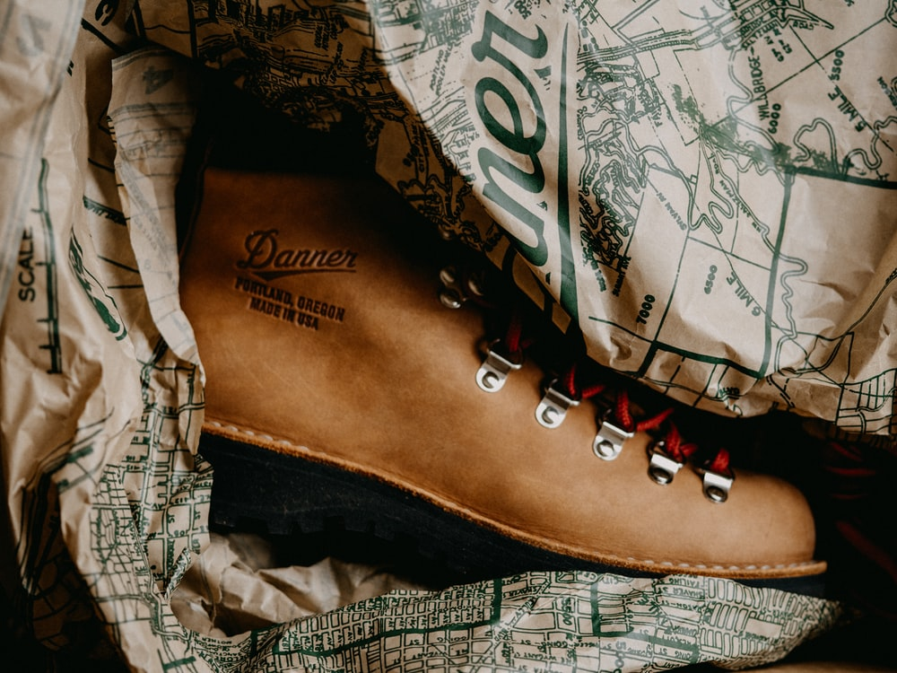 brown and black leather lace up shoe